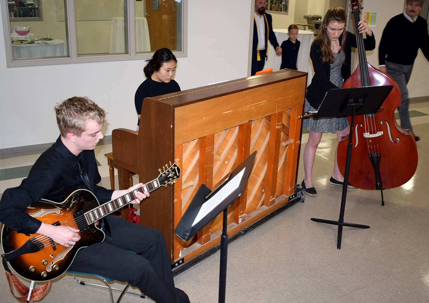 A jazz trio of student musicians provide dinner music.