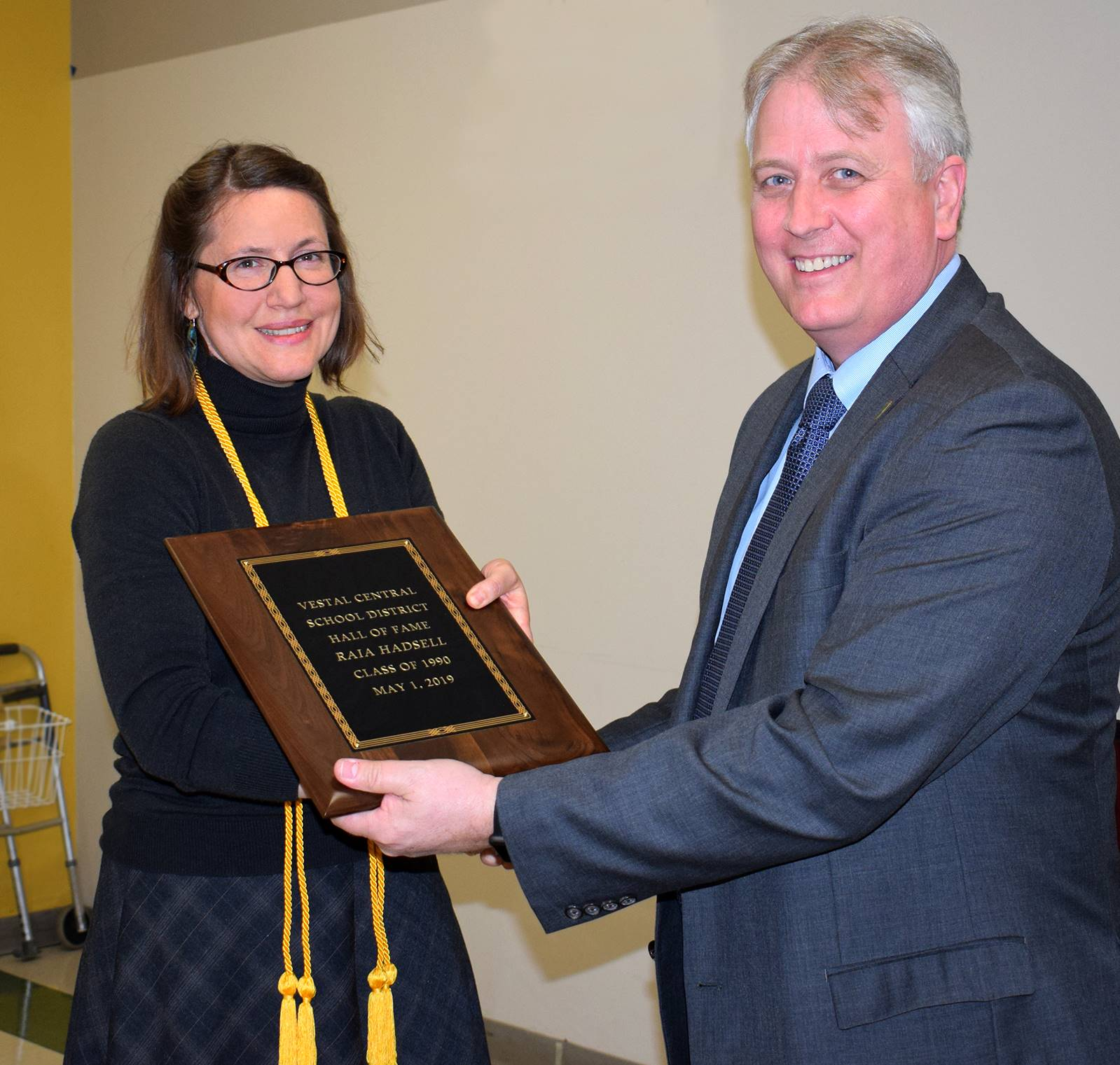 Dr. Raia Hadsell receives her Hall of Fame plaque from Superintendent Ahearn.