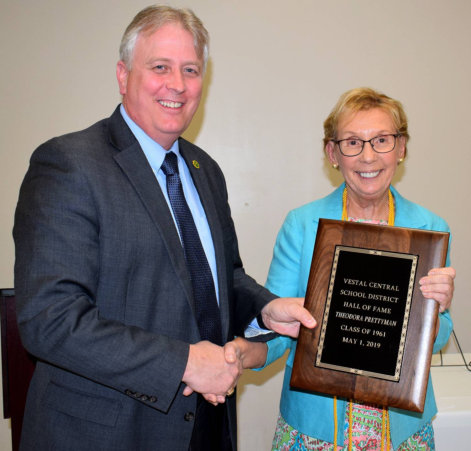 Superintendent Ahearn gives Hall of Fame Inductee Theodora Prettyman her plaque.