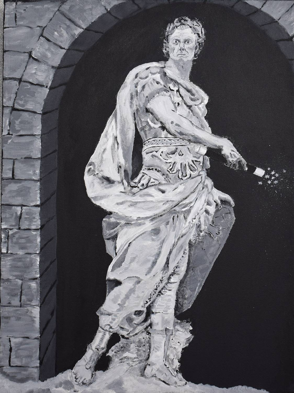 A Roman-style statue of a man in front of a bricked archway, in black and white.