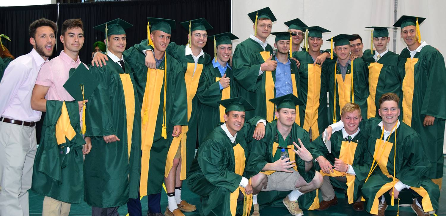 A large group of Vestal High School graduates pose for a group photo before the graduation ceremony
