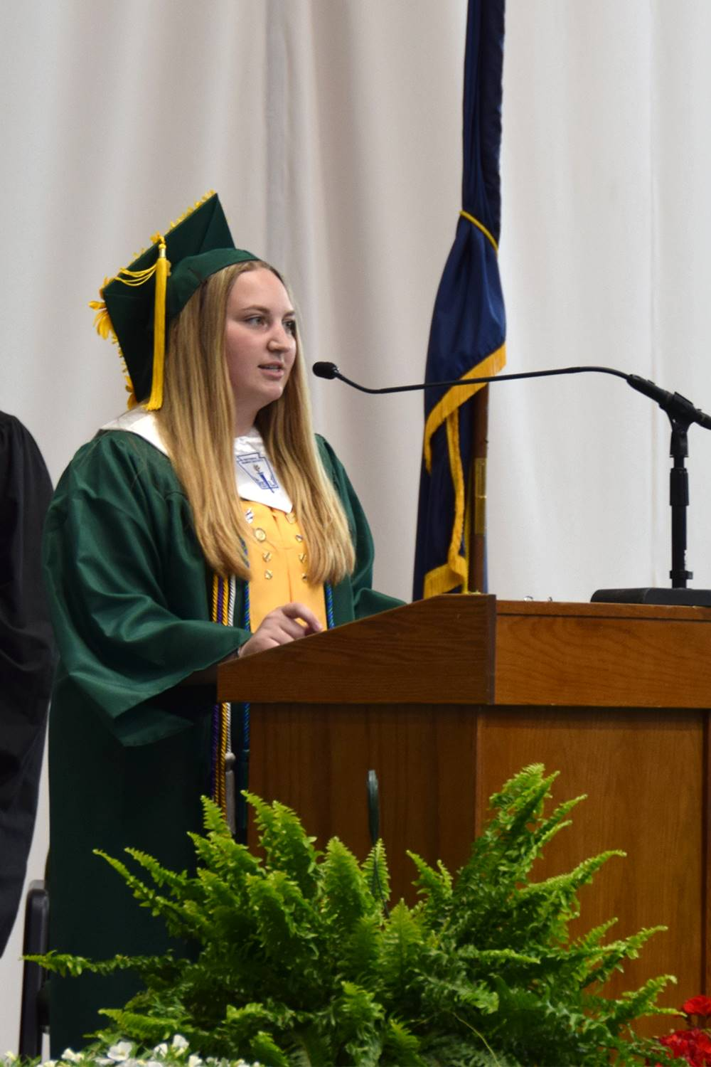 Vestal High School's National Honor Society President leads her class in the Pledge of Allegiance fo