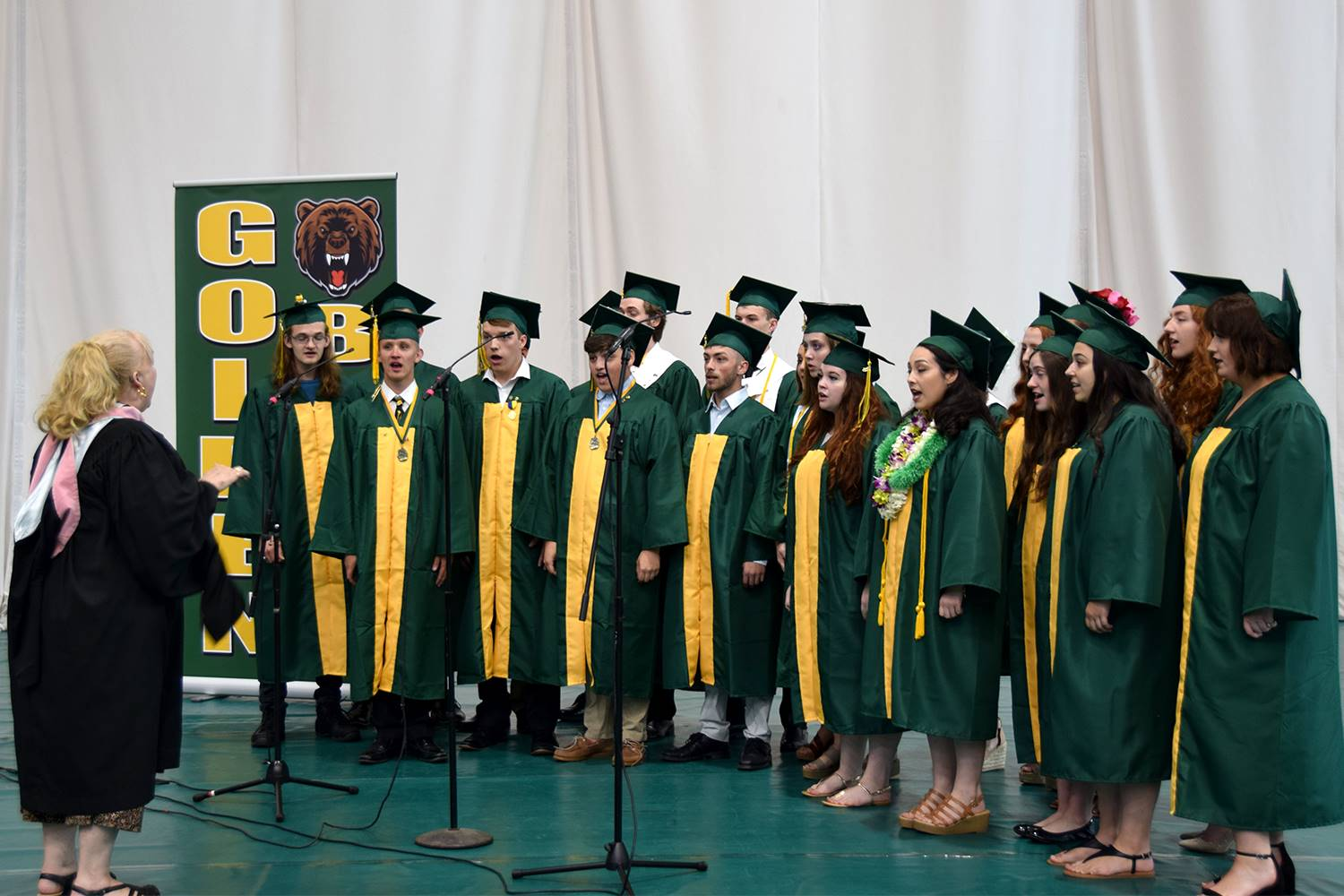 Senior members of the Vestal Voices sing Vestal High School's Alma Mater before their graduation cer