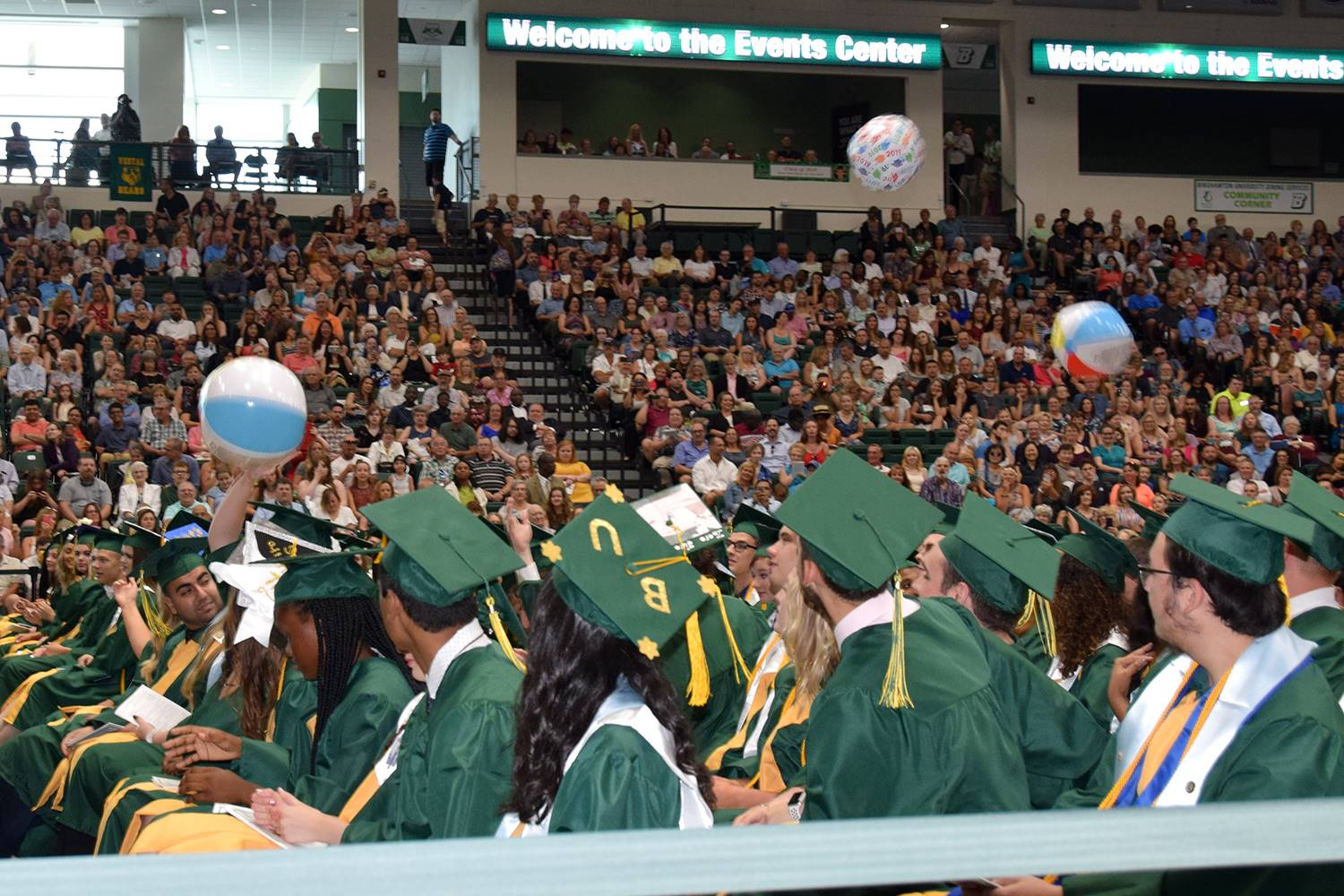 Beach balls are batted around during a break in the graduation ceremony.