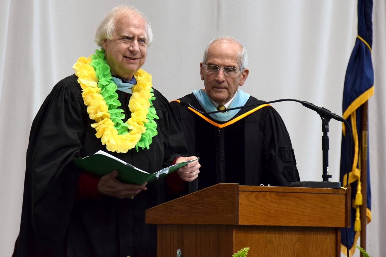 Retiring Vestal School Board President Michon Stuart accepts the Class of 2019 graduates as Interim