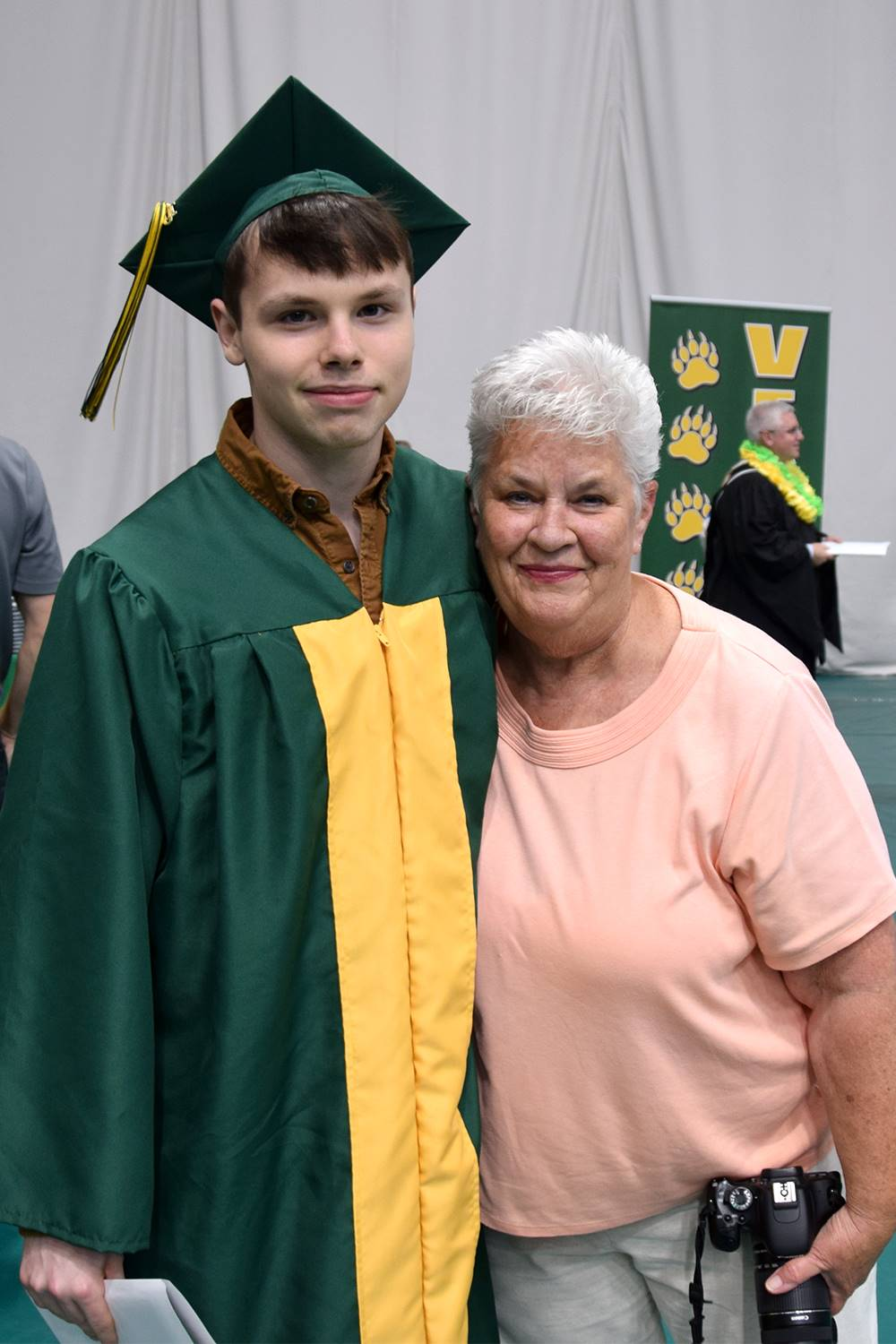 A Vestal High School graduate stands next to his grandmother after receiving his diploma.