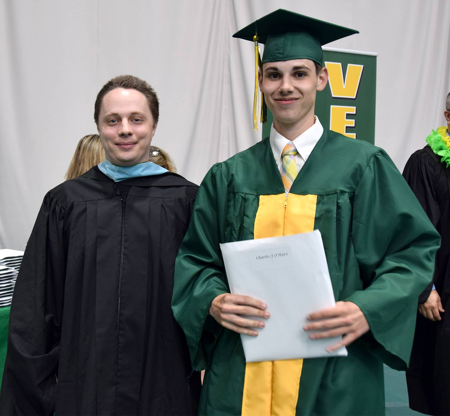 A Vestal High School teacher stands next to one of his students to which he presented his high schoo