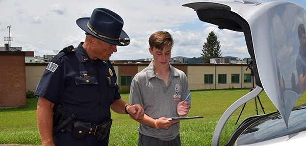 A Vestal Police sergeant instructs a Vestal High School Youth Police Academy cadet during a mock crime scenario on July 23, 2019.