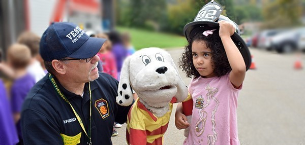Sparky the Fire Dog meets a Vestal Hills Elementary student during a fire safety lesson at the school in October 2018.