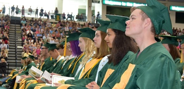 The front row of Vestal High School graduation candidates listen attentively during commencement speeches in the Binghamton University Events Center on June 29, 2019.