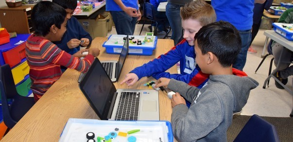 Two Vestal Hills Elementary fourth-grade boys grow excited as they finish building their L E G O  robot in the Maker Space room on January 24, 2020.
