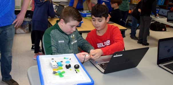 Two Vestal Hills Elementary fourth-grade boys work together to finish building their L E G O  robot in the Maker Space room on January 24, 2020.