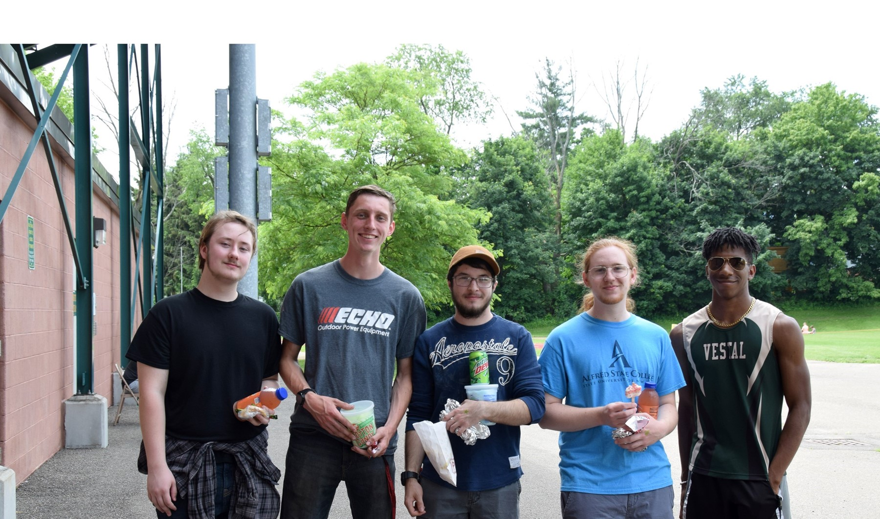 Five Vestal High senior guys hang out behind Hoover Stadium with their snacks during their Prom Promise Picnic on June 9, 2021.