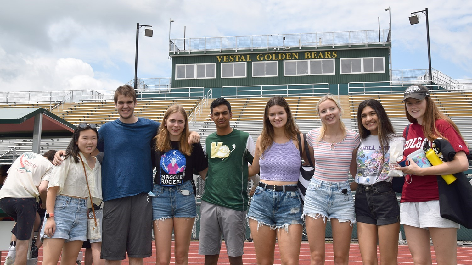 Eight Vestal High School seniors line up for a photo in Hoover Stadium during the Prom Promise Picnic on June 9, 2021.