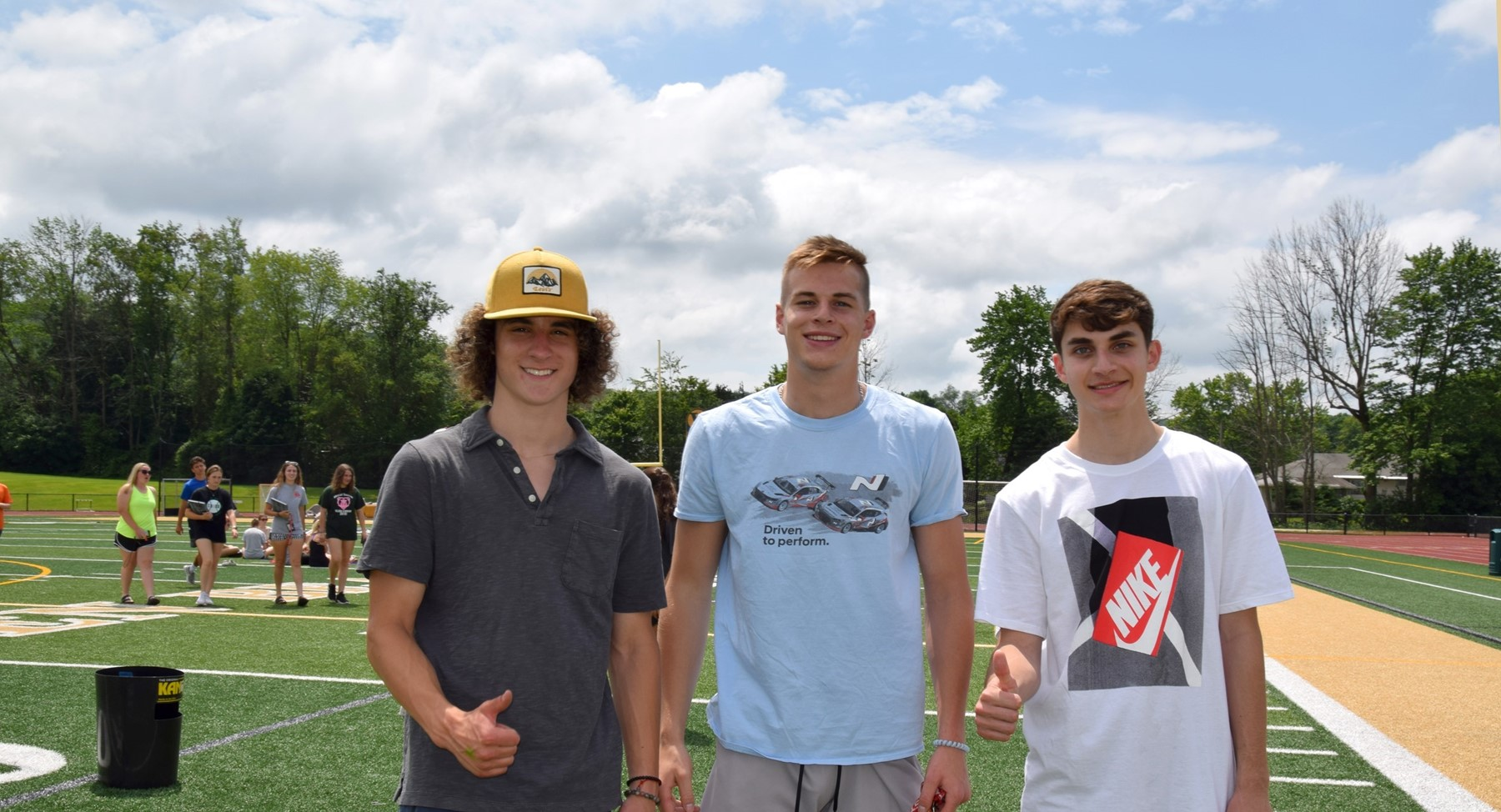 Three Vestal High School senior guys pose for a photo in Hoover Stadium during the Prom Promise Picnic on June 9, 2021.