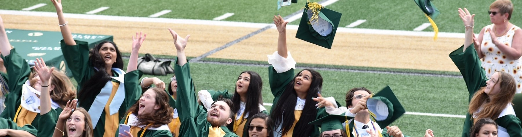 Vestal High School graduates from the Class of 2021 toss their green caps into the air inside Hoover Stadium following their commencement  ceremony on June 26, 2021.