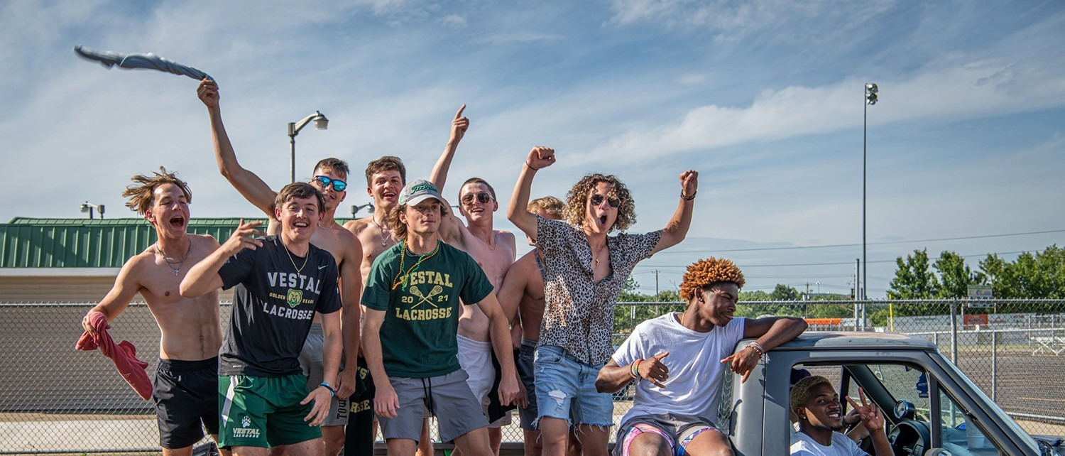 Vestal High School senior guys celebrate in the back of a pickup truck at the end of the Senior Car Parade on June 4, 2021.