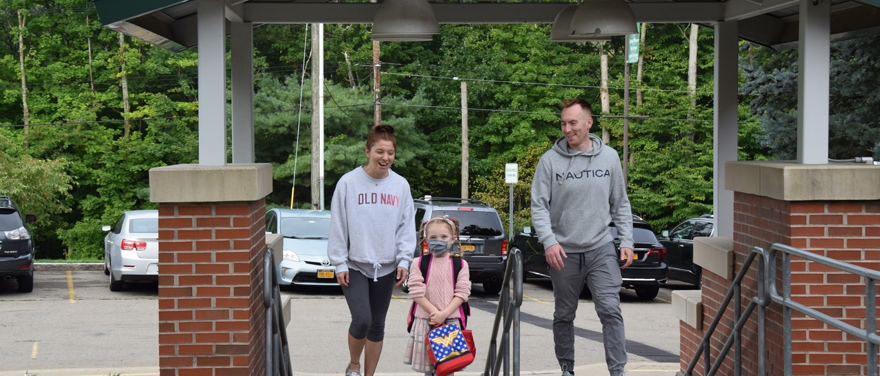 A mother and father walk their daughter up the Vestal Hills Elementary steps on the first day of school, September 9, 2021.