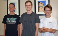 Three high school students , three seniors, who act as Vestal H.S. student announcers pose for a photo.